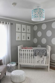 Use #neutral wall decals and frames to #decorate the walls of your gender neutral #nursery