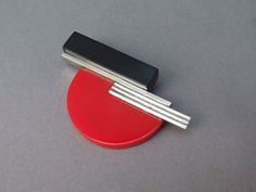 Bauhaus Brooch by JAKOB BENGEL  +++  Large chrome and galalith brooch, measures 3 inches (7.5cm) long and is fitted with a roll safety clasp.