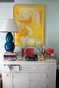 Lindsey Harper's NYC Apt: bold colors, graphic art, varied heights = perfection!