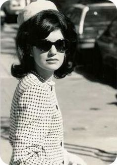 Jackie Kennedy seen here wearing a pillbox hat -- small hat with flat crown, straight upright sides, and no brim