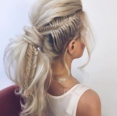 Cool braid and pony tail.