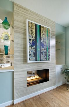 A faux-marble wall and view-through #fireplace add #contemporary flair to a newly #renovated #home in Sterling.  #INTERIOR #DESIGN: Olamar Interiors, LLC | See more projects at: http://www.HandD.com/PaolaMcDonald