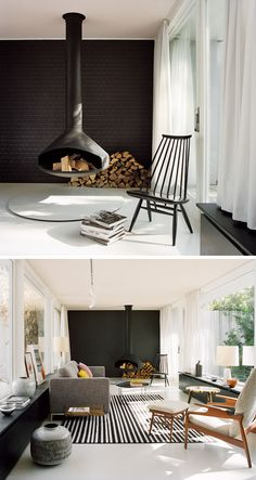 This modern living room features a hanging black fireplace, a black tile accent wall, modern furniture, light grey floors and a pale pink ceiling.