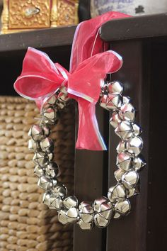 Embellish: {tutorial} Jingle Bell Wreaths- Made with a wire hanger! So easy!