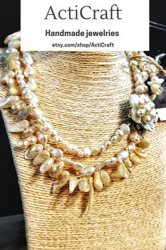 Handmade item Gemstone: Pearl Jewelry style: Art nouveau Description ActiCraft - Crafting Your Curiosity! Pearl necklace - Ivory pearl necklace for women with different baroque natural pearls, which is always relevant. pearl is a mineral of organic origin. It is formed by mollusk sands covered by sand layers. This handmade triple strand necklace with flower-shaped figure is very beautiful with wedding dress. Antique Pearl Necklace, Multi Strand Pearl Necklace, Real Pearl Necklace, Gemstone Necklace, Pearl Jewelry, Handmade Statement Necklace, Statement Necklaces, Charm Necklaces, Beaded Necklaces