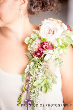 Looking for something out of the ordinary but incredibly unique for your mother? Why not try this over the shoulder wearable flower arrangement?! No doubt will bring mom many compliments throughout the day! Check out brendaabbott.net for this look! ©PPD Studios Photography www.ppdstudios.com