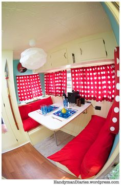 Renovated Vintage Camper - The dinette is aqua and red. :)