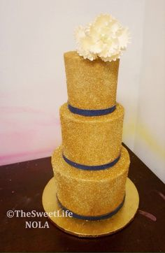 Gold Sparkle and Navy blue with flower Custom wedding cake by The Sweet Life Bakery New Orleans www.nolasweetlife.com email info@nolasweetlife.com (504)371-5153 #nolasweetlife @nolasweetlife