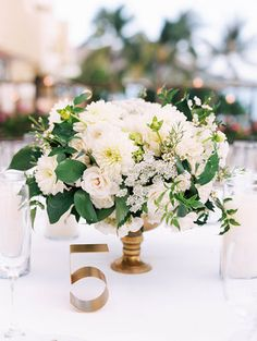 white and green centerpiece in gold vase by Passion Roots | Oahu | Honolulu, Hawaii Florist I Ashley Goodwin Photography