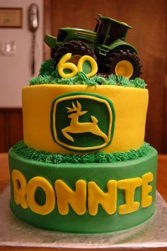john deere cake.. love the emblem and grass frosting - even have the tractor!
