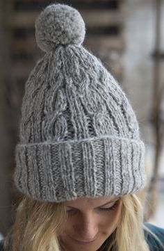 3015f52d6b706 Cable knit bobble hat in a natural oatmeal colour Bobble Hats
