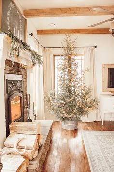 Scandinavian Christmas tree dried orange garland use of sheepskin white decor accents lots of wood and those wood beams! Scandinavian Christmas Decorations, Farmhouse Christmas Decor, Outdoor Christmas Decorations, Rustic Christmas, Christmas Home, Tree Decorations, Christmas Holidays, Christmas Music, Orange Christmas Tree