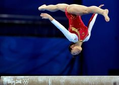Cheng Fei in an aerial backflip on beam. This is beautiful... <3