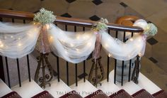 Tulle, lights, and baby's breath staircase decorations