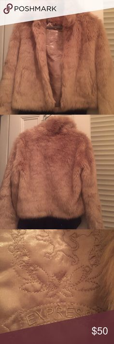 Faux fur coat Soft and cozy faux fur coat from Express. Size small. This coat has got a lot of life and love still in it! It's SUPER soft and warm and looks great from a NYE party to work. Express Jackets & Coats