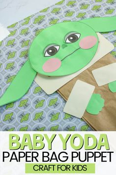 May the 4th Be With You!  Happy Star Wars Day!  Celebrate with this fun Baby Yoga Craft 🥳  This Baby Yoda Paper Bag Puppet is one of my favorite Crafts for Kids.  It's an easy Star Wars Themed craft that also offers hours of imaginative playtime.  #BabyYoda #DIYPuppet #CraftsforKids