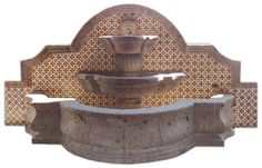 This wall mount cantera fountain decorated with Mexican tiles is a great idea for a large garden. It can be purchased without the basin nor ceramic tiles decorating back wall. by Rustica House #myRustica