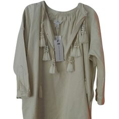 Pre-owned H&m Spring Collection 2014 Twill Tassel Tunic ($158) ❤ liked on Polyvore featuring tops, tunics, beige, drape top, drapey tops, tassel top, h&m tunic and beige top