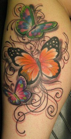 Tree colored butterflys tattoo but all in colour as with all of them. Xxx