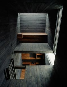 The black wood architecture here is very dignified and a bit mysterious. What an incredible effect!