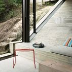 You work with the space you have ... brilliant use of concrete to deal with slope; built-in bench.