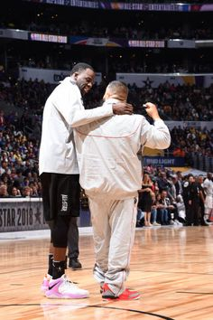 Draymond Green and DJ Khaled talk during the NBA AllStar Game as a part of 2018 NBA AllStar Weekend at STAPLES Center on February 18 2018 in Los...
