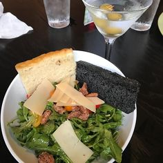 The martini had 2 olives the water had water and best of all the arugula salad came with black carbon bread roasted cherry tomato Gran Padano candied pecan and lemon balsamic vinaigrette.  Damn perfect at my new favorite restaurant - Mangia.