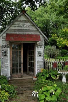 rustic garden shed, love the doors!