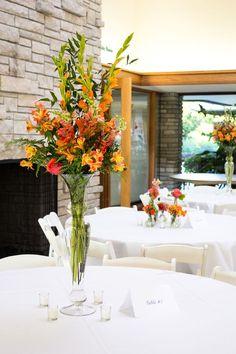 Tall orange centerpieces | Powell Gardens Grand Hall reception via handmakersofthings.com