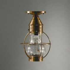 Northeast Lantern Onion Socket Caged Pear Semi Flush Mount Finish: Antique Copper, Shade Color: Clear