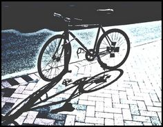 Bike Shadow by lbluejaye8 - I took this shot of a lone bicycle in Savannah because I loved the shadow against the brick street.