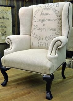 vintage grain sack upholstery. Maybe could do the same thing with stencil on linen fabric.  I have the chair already.