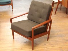 Dansmarc Teak Lounge Chair    1960's Danish. Signed J. Bone for Dansmark. Beautiful teak chair with brass connectors and lovely sculptural details. Original brown wool hopsack upholstery over spring cushions. Condition is mint