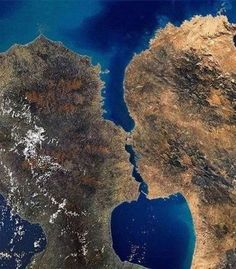Photo of two islands located in Greenland seen from the air look like kissing man and woman.