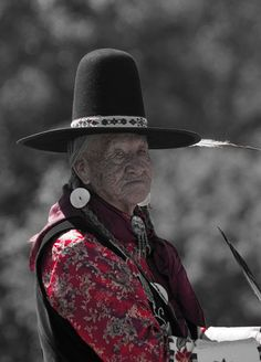 Crow Elder. gorgeous hat. all knowing stare.