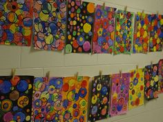 2nd grade Red + Yellow = Orange, Yellow + Blue = Green, and Red + Blue = Violet  The 2nd grade has been busy painting bubbles. When primary color bubbles come together, they painted the secondary color in the overlap!