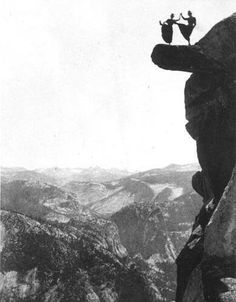 Kitty Tatch and friend dancing on the overhanging rock at Glacier Point, Yosemite, 1890s
