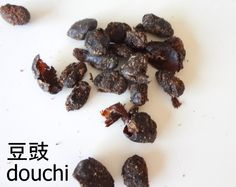 douchi, Chinese fermented black soy bean  Small, black soybeans that have been preserved in salt. Also known as Chinese black beans or salty or salted black beans, they have a very strong, salty flavour and are generally soaked in warm water for 30 minutes before using.