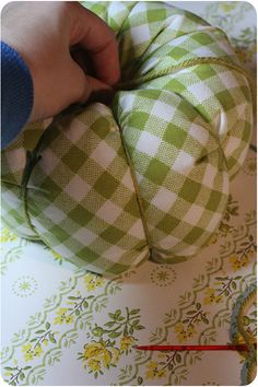 Tutorial on making fabric pumpkins ~ could use this pattern in a smaller size to make a pincushion.