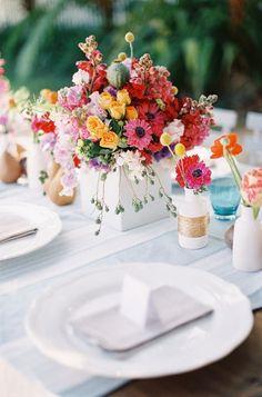 colorful wedding inspiration, anemones, roses, sweet peas, billy balls, orange pink red florals, white linens, fruit details