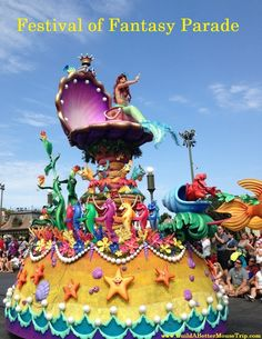 The Little Mermaid, proudly displaying her Dinglehopper, in the Festival of Fantasy Parade in the Magic Kingdom