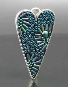 Seed bead mosaic - epoxy clay, seed beads, pearl, commercial cast base metal bezel