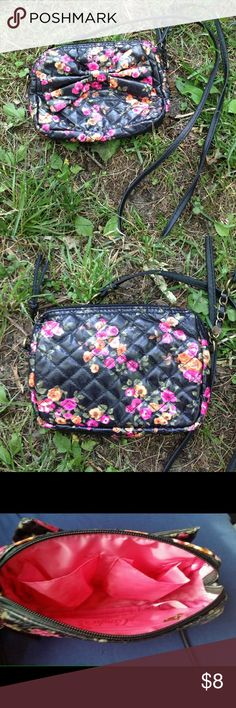 """Candies black and flowers small crossbody Candies black and flowers small cross body purse. Great condition. 7.5"""" across,5.5 high,2"""" wide Candie's Bags Crossbody Bags"""