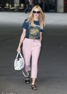 Stylish star: She looked lithe in the drainpipe cut trousers, which cut off just short of her ankles