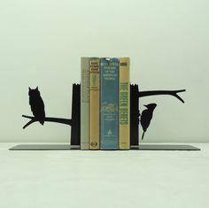A great series of bookends from Knob Creek Metal Arts includes the owl & the woodpecker http://www.knobcreekmetalarts.com/Bookends