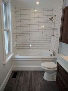 Simple bathroom for attic. Dark floors. White subway tile soft neutral walls. White vanity with brass or copper fixtures. by ^ kristen ^