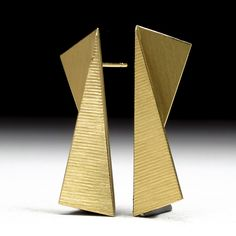 Geoffrey D. Giles 18K gold earrings that are folded with surface embellishment.