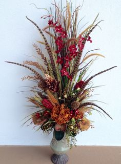 Dried arrangement designed by Arcadia Floral & Home Decor