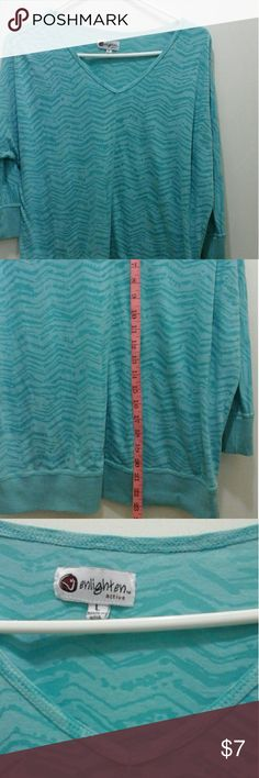 Slightly sheer tee - great for summer! 3/4 length sleeves. Turquoise color. 70% cotton, 30% polyester. Machine wash, line dry. Smoke free home. Enlighten Active Tops