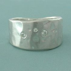 Hey, I found this really awesome Etsy listing at https://www.etsy.com/listing/179410872/sterling-silver-and-moissanite-ring-wide